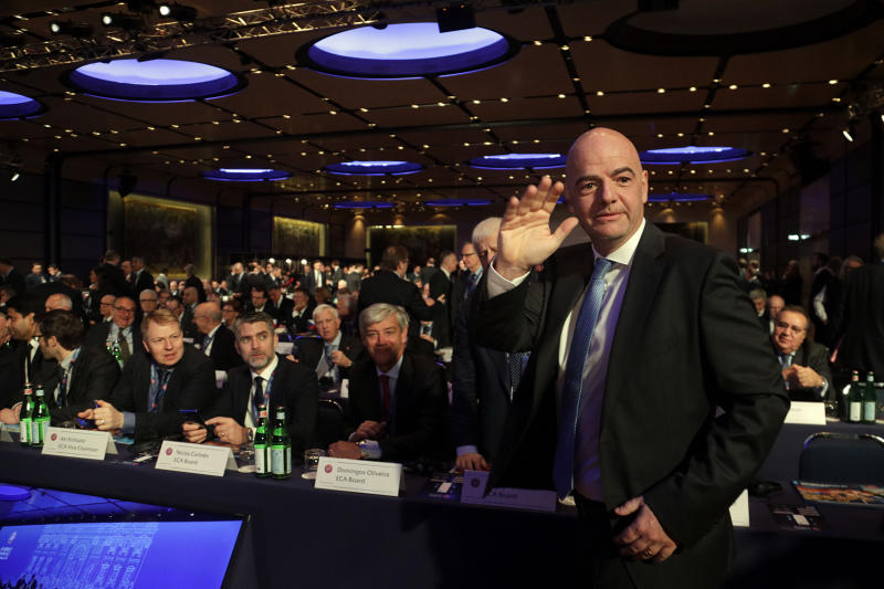 FIFA President Gianni Infantino waves to photographers as he arrives on the occession of the 43rd UEFA congress in Rome, Thursday, Feb. 7, 2019. As the only candidate for election, Infantino is set to serve four more years as the leader of soccer's governing body. (AP Photo/Gregorio Borgia)