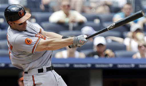 Baltimore Orioles' Taylor Teagarden follows through on an RBI single during the fourth inning of a baseball game against the New York Yankees on Saturday, July 6, 2013, in New York. (AP Photo/Frank Franklin II)