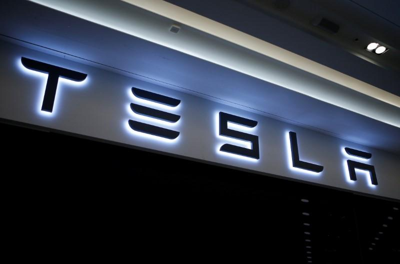 A Tesla logo is seen at its planned store in Hanam
