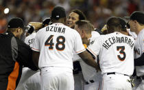 Miami Marlins' Henderson Alvarez, center, celebrates with teammates after pitching a no-hitter against the Detroit Tigers in an interleague baseball game on Sunday, Sept. 29, 2013, in Miami. The Marlins won 1-0. (AP Photo/Alan Diaz)