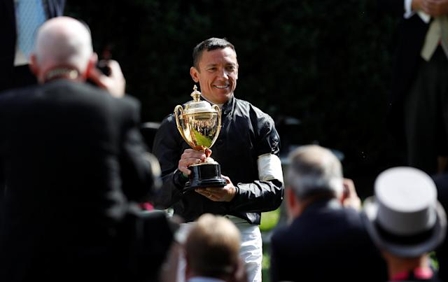 Horse Racing - Royal Ascot - Ascot Racecourse, Ascot, Britain - June 21, 2018 Frankie Dettori celebrates with the trophy after winning the 4.20 Gold Cup riding Stradivarius REUTERS/Peter Nicholls