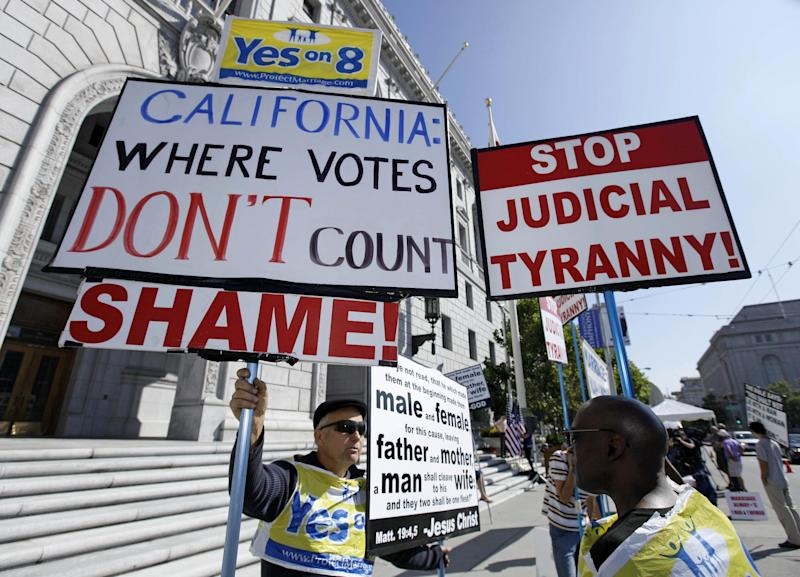 FILE - This Sept. 6, 2011 file photo shows opponents of gay marriage outside a courthouse in San Francisco where the California Supreme Court was hearing arguments on California's ban on same-sex marriage. The Supreme Court will take up California's ban on same-sex marriage, a case that could give the justices the chance to rule on whether gay Americans have the same constitutional right to marry as heterosexuals.  (AP Photo/Eric Risberg, File)