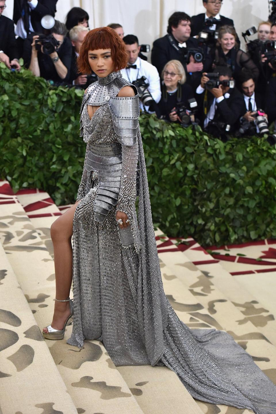 """<p><a class=""""link rapid-noclick-resp"""" href=""""https://www.popsugar.com/Zendaya"""" rel=""""nofollow noopener"""" target=""""_blank"""" data-ylk=""""slk:Zendaya"""">Zendaya</a> named her <a href=""""https://www.popsugar.com/fashion/Zendaya-Met-Gala-Dress-2018-44821237"""" class=""""link rapid-noclick-resp"""" rel=""""nofollow noopener"""" target=""""_blank"""" data-ylk=""""slk:Joan of Arc inspired Met Gala look"""">Joan of Arc inspired Met Gala look</a>, courtesy of Versace, as her favorite. She worked with Law Roach on the outfit in 2018, coordinating her knight's armor with Jimmy Choo heels and Tiffany &amp; Co. jewelry.</p>"""
