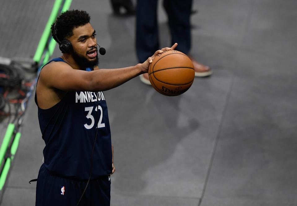 MINNEAPOLIS, MINNESOTA - DECEMBER 23: Karl-Anthony Towns #32 of the Minnesota Timberwolves wears a headset as he does an interview after the season opening game against the Detroit Pistons at Target Center on December 23, 2020 in Minneapolis, Minnesota. The Timberwolves defeated the Pistons 111-101. NOTE TO USER: User expressly acknowledges and agrees that, by downloading and or using this Photograph, user is consenting to the terms and conditions of the Getty Images License Agreement (Photo by Hannah Foslien/Getty Images)