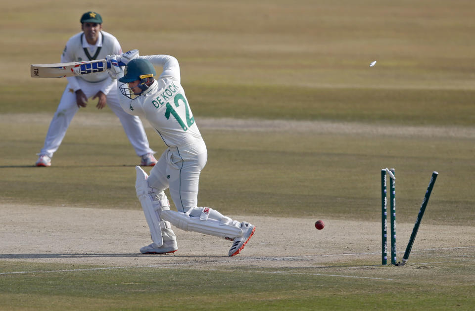 South Africa's Quinton de Kock, front, is bowled by Pakistan's Shaheen Afridi while teammate Abid Ali watches during the third day of the second cricket test match between Pakistan and South Africa at the Pindi Stadium in Rawalpindi, Pakistan, Saturday, Feb. 6, 2021. (AP Photo/Anjum Naveed)