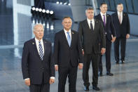 President Joe Biden and other NATO heads of the states and governments pose for a family photo during the NATO summit at the Alliance's headquarters, in Brussels, Belgium, Monday, June 14, 2021. (Kevin Lamarque/Pool via AP)