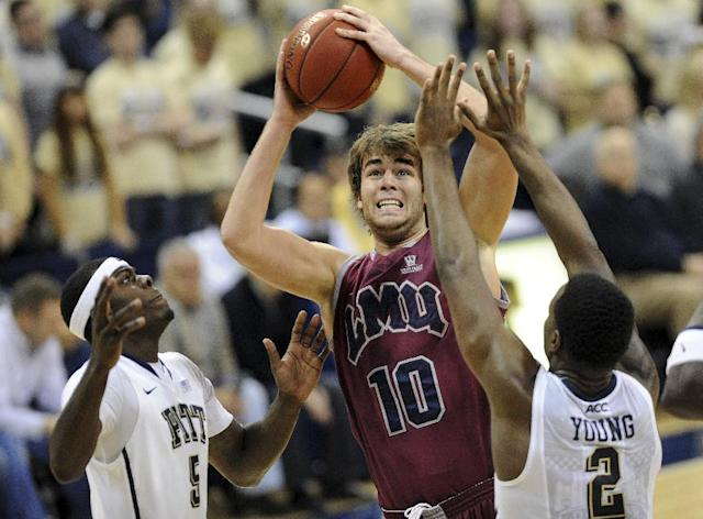 Loyola Marymount forward Ben Dickinson (10) looks to shoot as Pittsburgh forward Durand Johnson (5) and forward Michael Young (2) defend during the second half of an NCAA college basketball game on Friday, Dec. 6, 2013, in Pittsburgh. Pittsburgh won 85-68. (AP Photo/Don Wright)