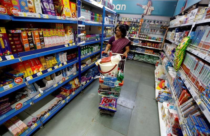 FILE PHOTO: A woman pushes a shopping trolley at a food superstore in Ahmedabad
