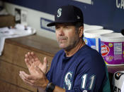 FILE - In this Aug. 10, 2017, file photo, Seattle Mariners hitting coach Edgar Martinez applauds in the dugout before a baseball game against the Los Angeles Angels in Seattle. Martinez, Mariano Rivera and Roy Halladay seem likely to be elected to baseballs Hall of Fame on Tuesday, Jan. 22, 2019. (AP Photo/Elaine Thompson)