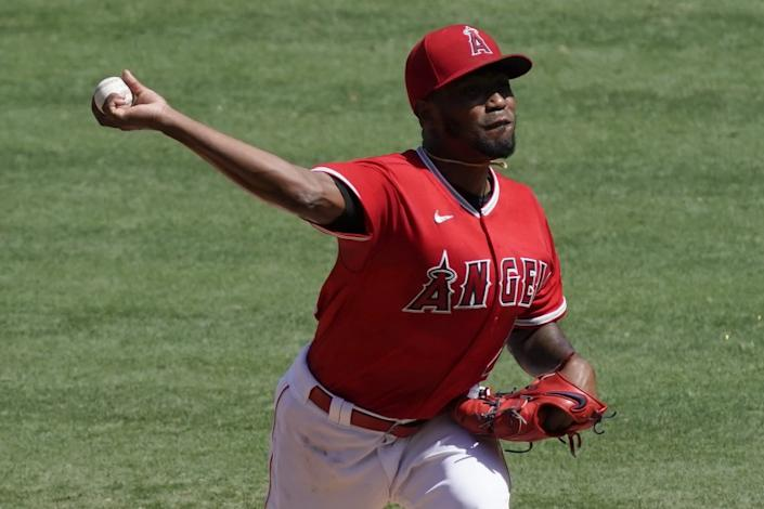 Los Angeles Angels starting pitcher Julio Teheran throws to the Texas Rangers.