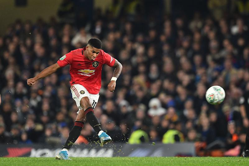 Manchester United's English striker Marcus Rashford takes a penalty and scores his team's second goal during the English League Cup fourth round football match between Chelsea and Manchester United at Stamford Bridge in London on October 30, 2019. (Photo by Glyn KIRK / AFP) / RESTRICTED TO EDITORIAL USE. No use with unauthorized audio, video, data, fixture lists, club/league logos or 'live' services. Online in-match use limited to 75 images, no video emulation. No use in betting, games or single club/league/player publications. / (Photo by GLYN KIRK/AFP via Getty Images)