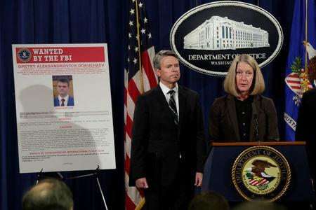 Acting AAG for National Security Mary McCord speaks in front of a poster of a suspected Russian hacker during FBI National Security Division and the U.S. Attorney's Office for the Northern District of California joint news conference at the Justice Department in Washington, U.S., March 15, 2017. REUTERS/Yuri Gripas