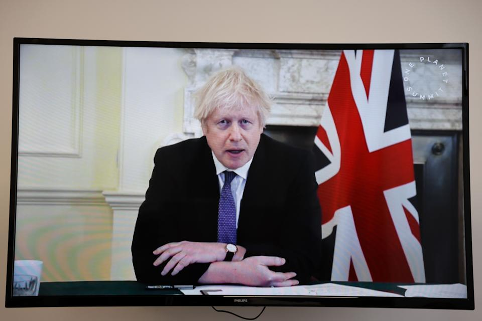 Britain's Prime Minister Boris Johnson speaks during a video conference at the One Planet Summit, part of World Nature Day, at the Reception Room of the Elysee Palace, in Paris, on January 11, 2021. - The One Planet Summit, a largely virtual event hosted by France in partnership with the United Nations and the World Bank, will include French President, German Chancellor and European Union chief. (Photo by Ludovic MARIN / various sources / AFP) (Photo by LUDOVIC MARIN/AFP via Getty Images)
