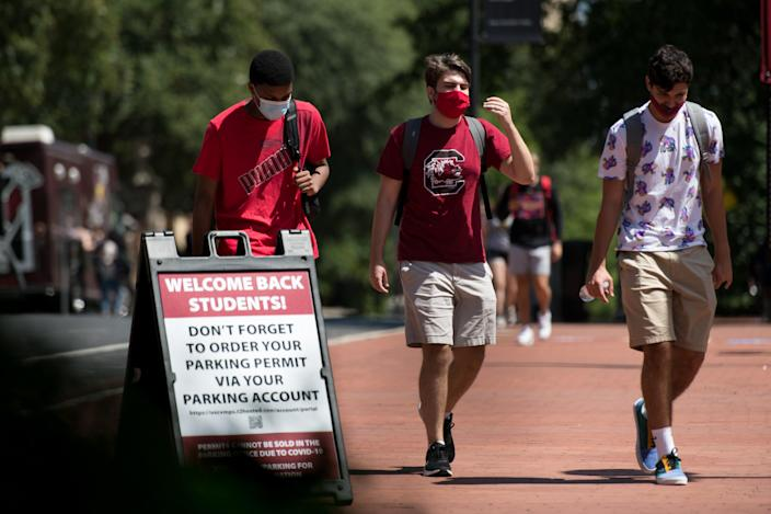 COLUMBIA, SC - SEPTEMBER 03: Students walk on campus at the University of South Carolina on September 3, 2020 in Columbia, South Carolina. During the final week of August, the university reported a 26.6 percent positivity rate among the student population tested for the COVID-19 virus. (Photo by Sean Rayford/Getty Images)