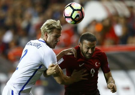 Football Soccer - Turkey v Finland - 2018 World Cup Qualifying European Zone - Antalya arena, Antalya, Turkey - 24/3/17 Turkey's Cenk Tosun and Finland's Paulus Arajuuri in action. REUTERS/Murad Sezer