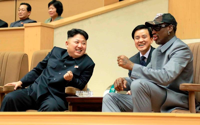 Kim Jong Un and Dennis Rodman watch a basketball game between former US NBA basketball players and North Korean players in Pyongyang in 2014 - Reuters