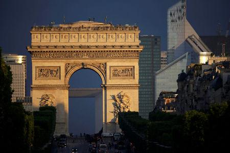 General view of the Champs Elysees, the Arc de Triomphe and the La Defense business district, in Paris, France, July 14, 2012.    REUTERS/Mal Langsdon/File Photo