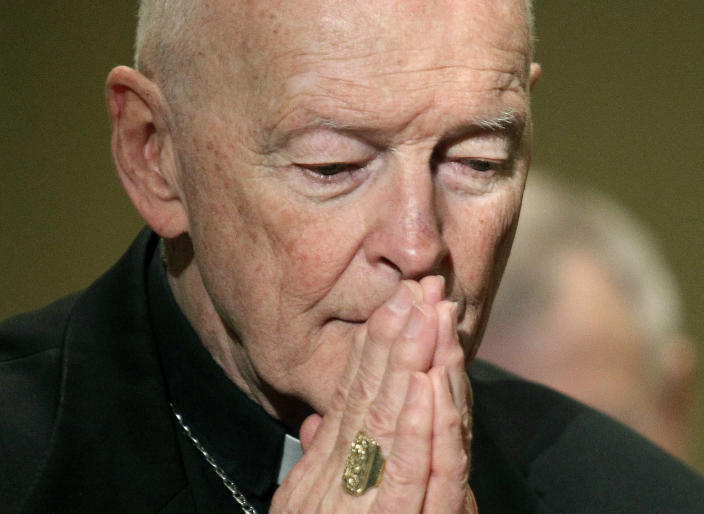 FILE - In this Nov. 14, 2011 file photo, Cardinal Theodore McCarrick prays during the United States Conference of Catholic Bishops' annual fall assembly in Baltimore. On Tuesday, Nov. 10, 2020, the Vatican is taking the extraordinary step of publishing its two-year investigation into the disgraced ex-Cardinal McCarrick, who was defrocked in 2019 after the Vatican determined that years of rumors that he was a sexual predator were true. (AP Photo/Patrick Semansky, File)