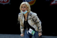 Baylor head coach Kim Mulkey talks to her players during the second half of an NCAA college basketball game against West Virginia in the final round of the Big 12 Conference tournament in Kansas City, Mo, Sunday, March 14, 2021. (AP Photo/Charlie Riedel)