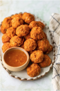"""<p>A spicy marmalade perfectly complements this finger food. The entire batch will be gone in no time. </p><p><strong>Get the recipe at <a href=""""https://www.thecookierookie.com/sweet-potato-sausage-cheese-balls/"""" rel=""""nofollow noopener"""" target=""""_blank"""" data-ylk=""""slk:The Cookie Rookie"""" class=""""link rapid-noclick-resp"""">The Cookie Rookie</a>.</strong></p>"""
