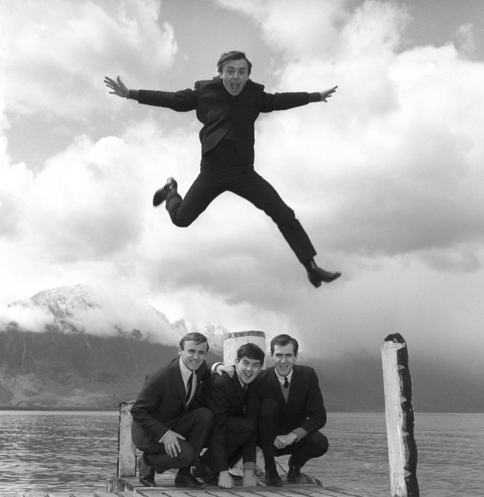 "FILE - In this April 25, 1964 file photo, Gerry Marsden leaps over his band, the Pacemakers. Gerry Marsden, the British singer and lead singer of Gerry and the Pacemakers, who was instrumental in turning a song from the Rodgers and Hammerstein musical ""Carousel"" into one of the great anthems in the world of football, has died. He was 78. (PA via AP, File)"