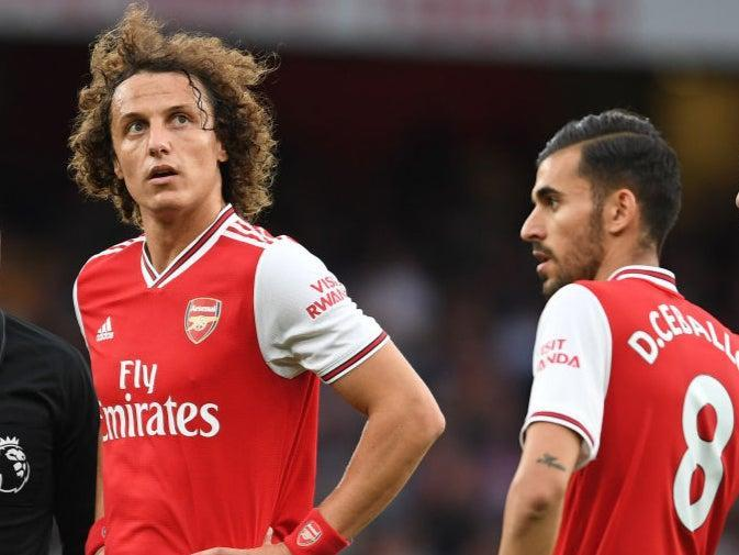Arsenal teammates David Luiz and Dani Ceballos (Arsenal FC via Getty Images)