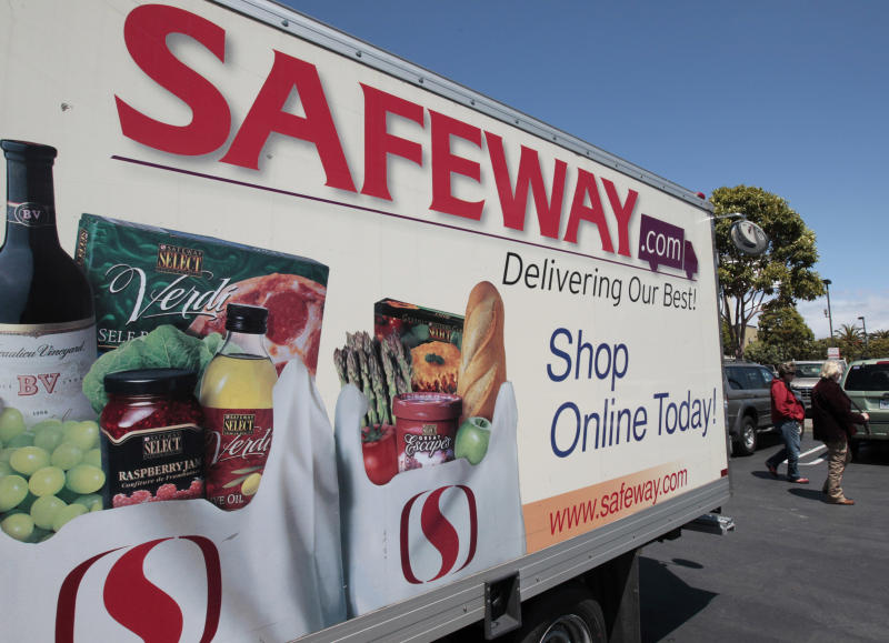 FILE- In this Thursday, April 26, 2012, file photo, a Safeway online shopping advertisement is shown at a Safeway store in San Francisco. Safeway Inc. said Thursday, July 19, 2012, that its net income fell 16 percent in the second quarter, as the grocery store operator spent more on advertising and fought to hold onto customers amid growing competition. (AP Photo/Paul Sakuma, File)