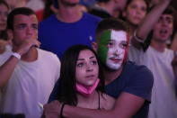 Fans watch on a giant screen in Rome, Sunday, July 11, 2021, the Euro 2020 soccer championships' final match between Italy and England played at Wembley stadium in London. (AP Photo/Gregorio Borgia)
