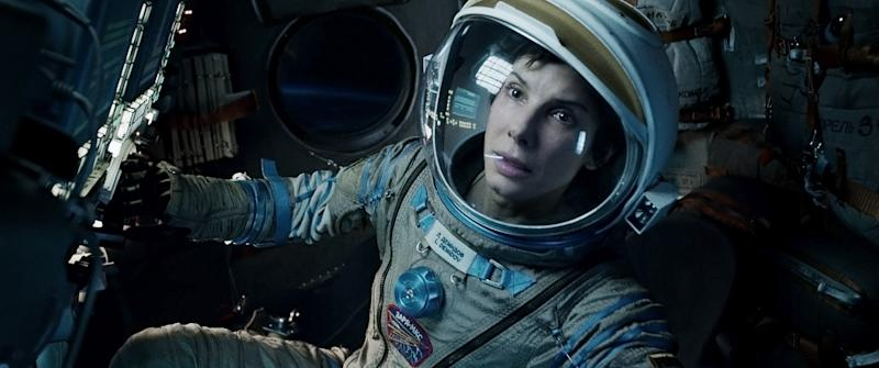 """FILE - This film image released by Warner Bros. Pictures shows Sandra Bullock in a scene from """"Gravity."""" Topping the box office for the third straight week, the space adventure """"Gravity"""" continues to be the box-office juggernaut of the fall. The film, starring Sandra Bullock, earned $31 million over the weekend, according to studio estimates Sunday, Oct. 20, 2013. (AP Photo/Warner Bros. Pictures, File)"""