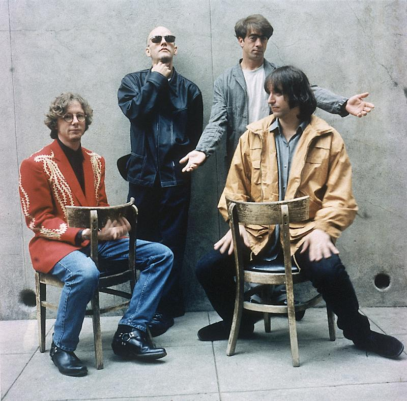 """FILE - In this 1994 file photo originally released by Warner Bros. Records, alternative rock band R.E.M., from left, Mike Mills, Michael Stipe, Bill Berry, and Peter Buck are shown when they released their new album """"Monster.""""  The band announced Wednesday, Sept. 21, 2011 on their website that they are breaking up. (AP Photo/Warner Bros.)"""
