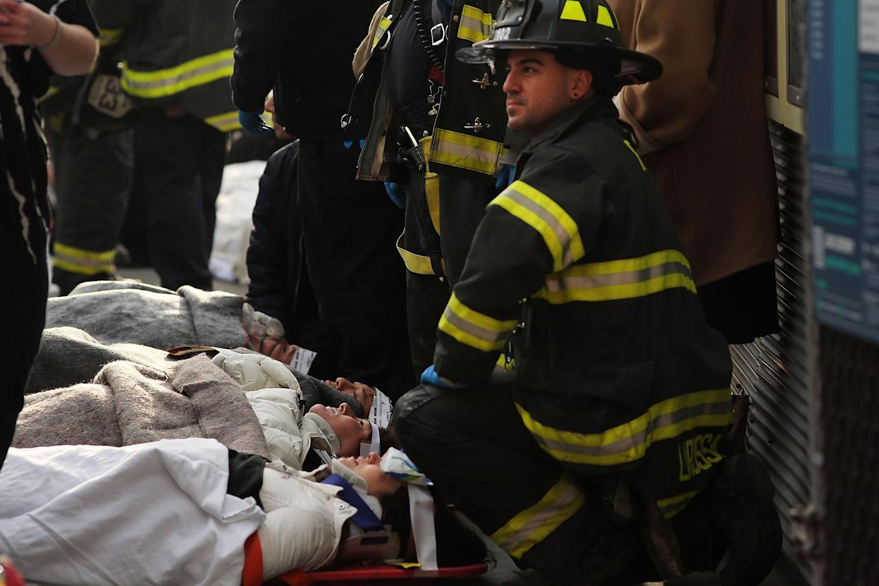 NEW YORK, NY - JANUARY 09:  Injured passengers are aided following an early morning ferry accident during rush hour in Lower Manhattan on January 9, 2013 in New York City. About 50 people were injured in the accident, which left a large gash on the front side of the Seastreak ferry at Pier 11.  (Photo by Spencer Platt/Getty Images)