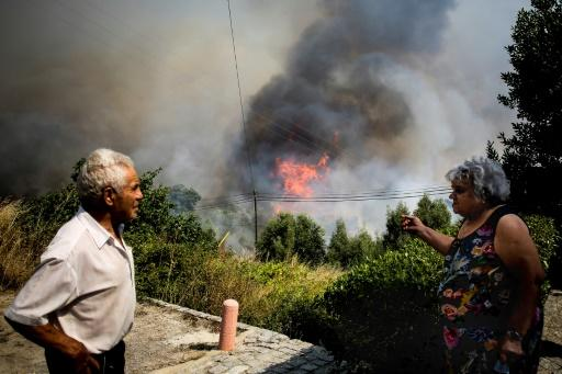 In the southern Portuguese holiday region, residents and tourists have been evacuated from around an Algarve resort town as fire crews struggled to extinguish wildfires that have left 30 people injured, one seriously