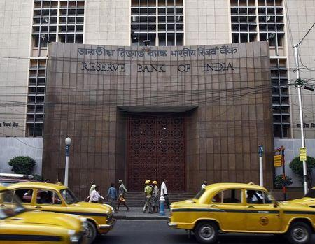 Commuters travel past Reserve Bank of India building in Kolkata