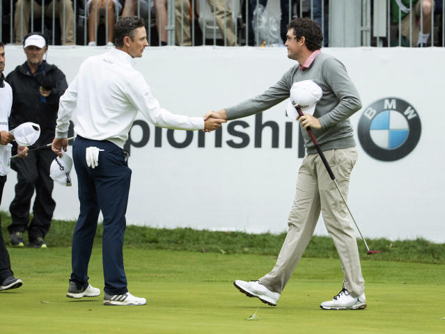 Justin Rose, of England, left, and Keegan Bradley shakes hands after the BMW Championship golf tournament at the Aronimink Golf Club, Monday, Sept. 10, 2018, in Newtown Square, Pa. Bradley held off Rose in a sudden-death playoff to win the rain-plagued BMW Championship for his first PGA Tour victory in six years. (AP Photo/Chris Szagola)