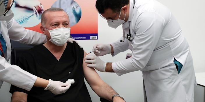 ANKARA, Jan. 14, 2021 -- Turkish President Recep Tayyip Erdogan C receives a dose of COVID-19 vaccine at a hospital in Ankara, Turkey, on Jan. 14, 2021. Erdogan on Thursday received his first dose of vaccine as Turkey has started mass vaccination against COVID-19. (Photo by Xinhua via Getty) (Xinhua/Xinhua via Getty Images)