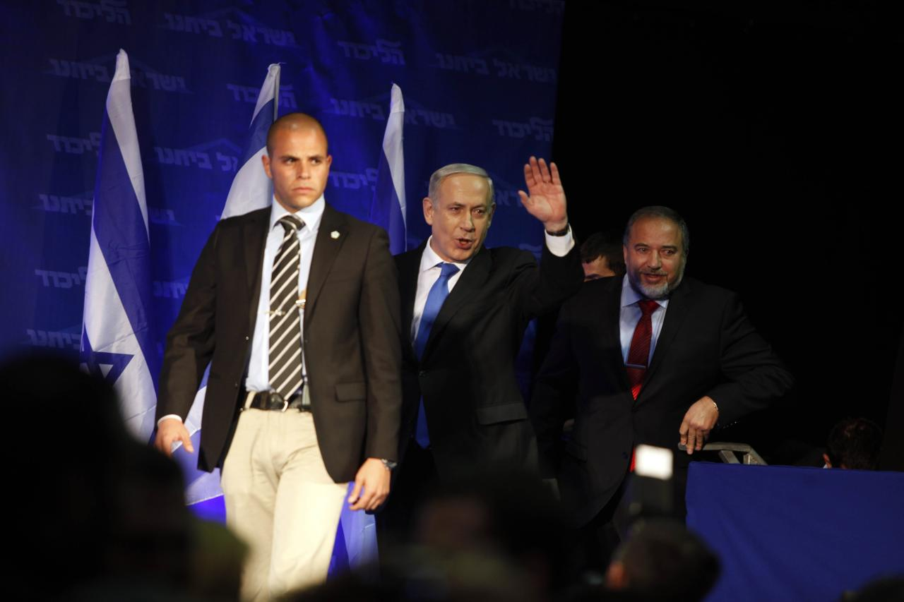 TEL AVIV, ISRAEL - JANUARY 23: (ISRAEL OUT) Israeli Prime Minister Benjamin Netanyahu waves to supporters at his election campaign headquarters on Janurary 23, 2013 in Tel Aviv, Israel. Netanyahu was re-elected for a third term and will return to office, according to exit polls. Israel had the highest turnout of voters since 1999. (Photo by Lior Mizrahi /Getty Images)