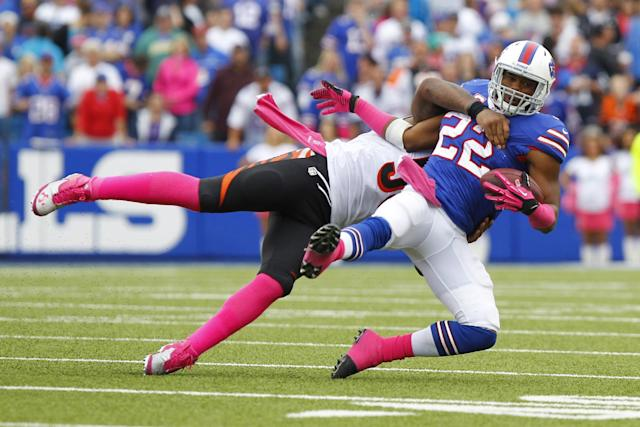 Buffalo Bills running back Fred Jackson (22) is hit by Cincinnati Bengals outside linebacker Vontaze Burfict (55) after making a catch in the third quarter of the NFL football game on Sunday, Oct. 13, 2013, in Orchard Park, N.Y. (AP Photo/Bill Wippert)