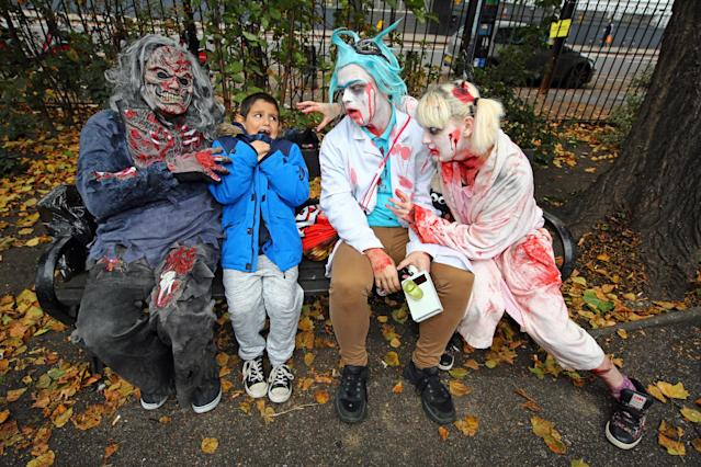 <p>Participants dressed as zombies wander through London on a pub crawl for World Zombie Day to aid homeless charity St. Mungos World Zombie Day in London on Oct. 7, 2017. (Photo: Paul Brown/REX/Shutterstock) </p>