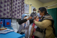A health worker engages in a COVID-19 vaccine delivery system trial in New Delhi, India, Saturday, Jan. 2, 2021. India tested its COVID-19 vaccine delivery system with a nationwide trial on Saturday as it prepares to roll-out an inoculation program to stem the coronavirus pandemic. Saturday's exercise included necessary data entry into an online platform for monitoring vaccine delivery, along with testing of cold storage and transportation arrangements for the vaccine, the health ministry had said.(AP Photo/Altaf Qadri)