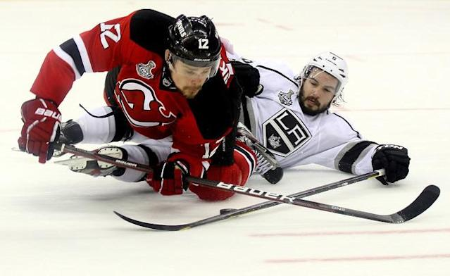 NEWARK, NJ - JUNE 09: Alexei Ponikarovsky #12 of the New Jersey Devils collides with Drew Doughty #8 of the Los Angeles Kings during Game Five of the 2012 NHL Stanley Cup Final at the Prudential Center on June 9, 2012 in Newark, New Jersey. (Photo by Elsa/Getty Images)