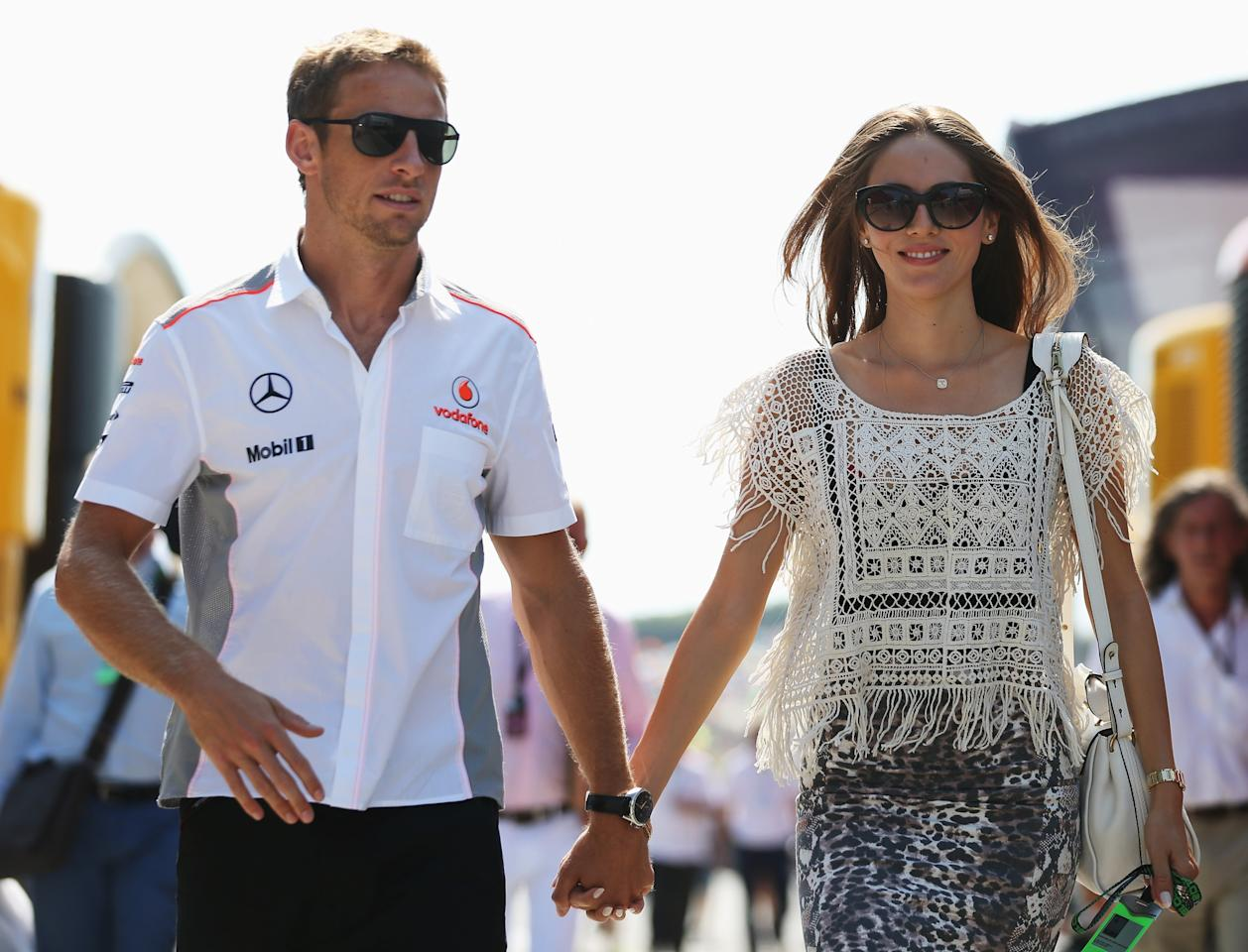 BUDAPEST, HUNGARY - JULY 28: Jenson Button of Great Britain and McLaren and his girlfriend Jessica Michibata arrive in the paddock before the Hungarian Formula One Grand Prix at Hungaroring on July 28, 2013 in Budapest, Hungary. (Photo by Mark Thompson/Getty Images)