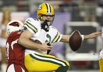 Cardinals cornerback Michael Adams causes an Aaron Rodgers fumble in overtime. Arizona's Karlos Dansby recovered the fumble and ran it in for a touchdown. Arizona won 51-45