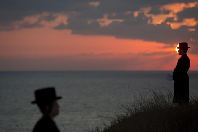 <p>Ultra-Orthodox Jews of the Hassidic sect Vizhnitz gather on a hill overlooking the Mediterranean sea as they participate in a Tashlich ceremony in Herzeliya, Israel, Oct. 2, 2014. (Photo: Oded Balilty/AP) </p>