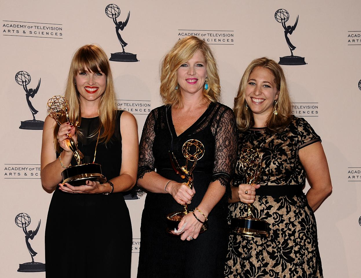 From left, Katia Blichfeld, Jennifer McNamara-Shroff and Jessica Daniels pose in the press room at the 2013 Primetime Creative Arts Emmy Awards, on Sunday, September 15, 2013 at Nokia Theatre L.A. Live, in Los Angeles, Calif. (Photo by Scott Kirkland/Invision for Academy of Television Arts & Sciences/AP Images)