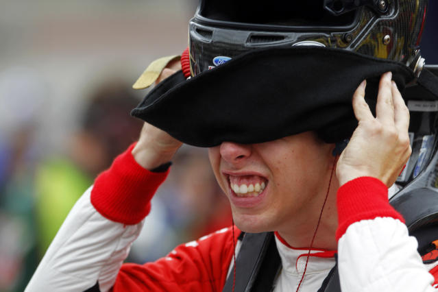 Driver Brad Keselowski (2) puts on his helmet before practice for the Irwin Tools Night Race NASCAR Sprint Cup Series auto race at Bristol Motor Speedway on Friday, Aug. 22, 2014, in Bristol, Tenn. (AP Photo/Wade Payne)