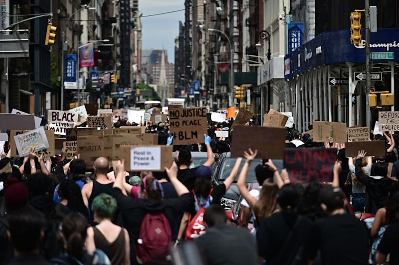 "Protesters demonstrate on June 2, 2020, during a ""Black Lives Matter"" protest in New York City. - Anti-racism protests have put several US cities under curfew to suppress rioting, following the death of George Floyd while in police custody. (Photo by Johannes EISELE / AFP) (Photo by JOHANNES EISELE/AFP via Getty Images)"