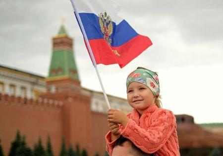 A young girl holds a Russian flag in Red Square, Moscow, Russia, July 3, 2018. REUTERS/John Sibley