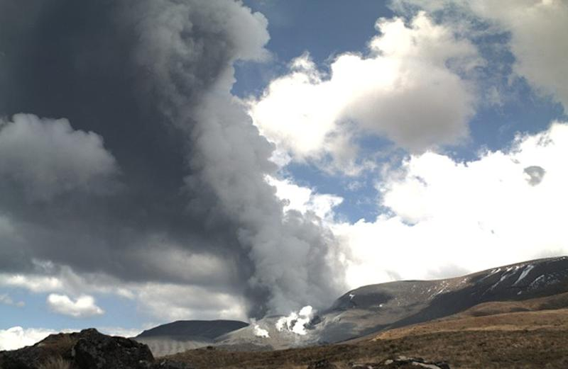 In this photo released by the Institute of Geological and Nuclear Sciences (GNS) smoke billowing out of Te Maari crater on Mount Tongariro, New Zealand after a brief eruption Wednesday, Nov. 21, 2012. The New Zealand volcano erupted with a brief blast of dark ash Wednesday, canceling flights but causing no significant damage. Schoolchildren and dozens of other hikers who were walking on trails along the mountain's base were safe. (AP Photo/GNS)