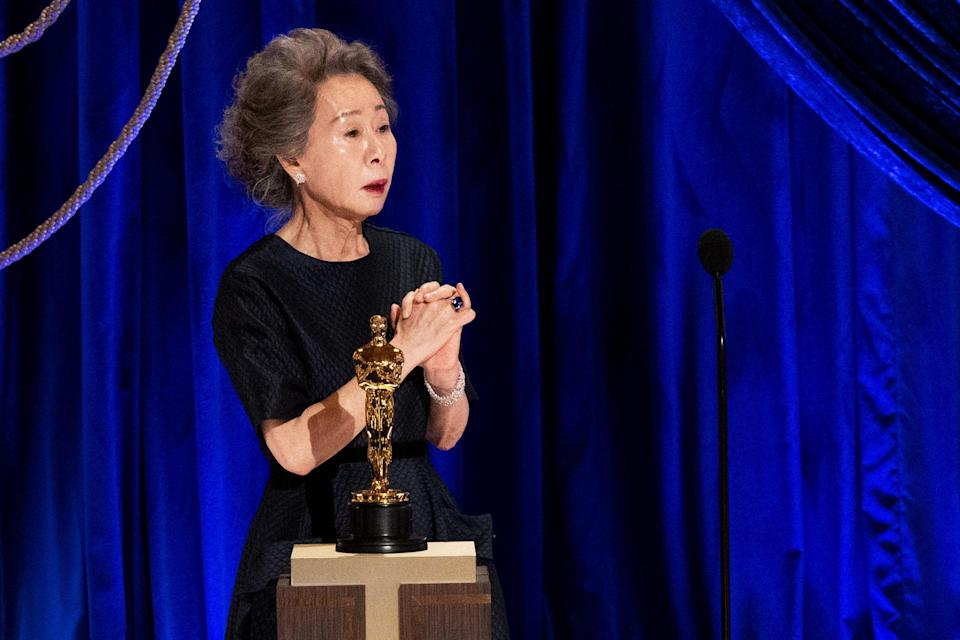 Youn Yuh-jung accepts the Oscar for best actress in a supporting role for