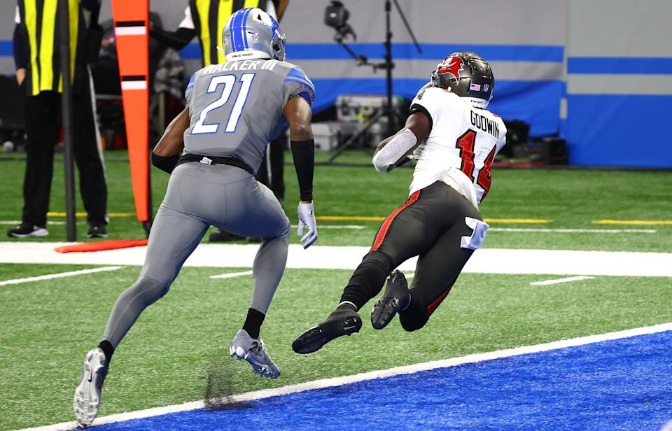 Tampa Bay Buccaneers receiver Chris Godwin makes a diving 7-yard touchdown catch against Detroit Lions safety Tracy Walker during the second quarter at Ford Field on Dec. 26, 2020 in Detroit.